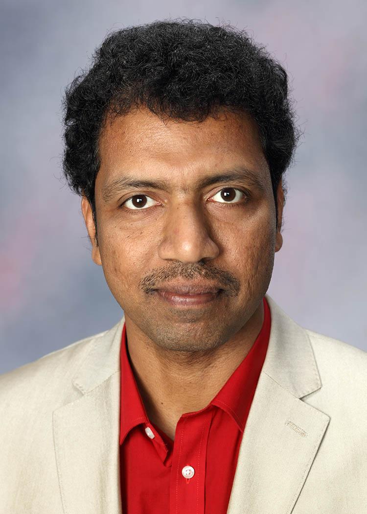 A. Prof. Babu George.jpg
